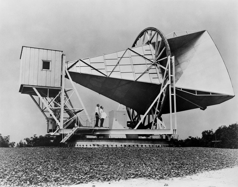 Arno Penzias and Robert Wilson stand on top of the Holmdel Horn Antenna, the site where the first evidence for the big bang was detected.